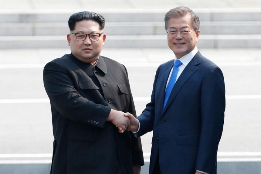 North Korea's leader Kim Jong Un (left) shaking hands with South Korea's President Moon Jae-in at the Military Demarcation Line at the truce village of Panmunjom, on Aug 13, 2018.