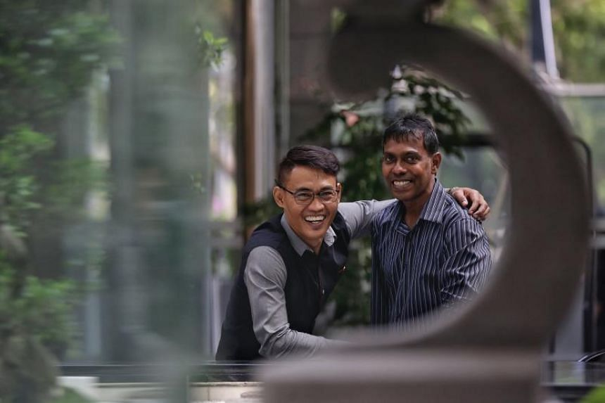 Mr Abdul Aziz Md Sani (left), 45, nominated his supervisor Mr N. Chandramohan, 53, for the Model Supervisor Award from the Singapore Corporation of Rehabilitative Enterprises (Score). He said that Mr Chandramohan guided him patiently in his work, enc