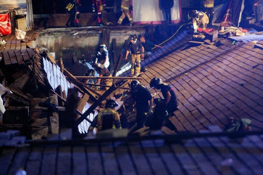 Firefighters search for victims after a wooden platform collapsed during a concert in Vigo, Spain, on Aug 12, 2018.