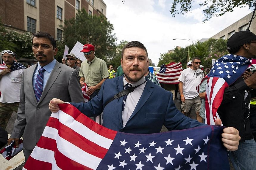 """White supremacist Jason Kessler and members of the alt-right marching to the White House as part of the """"Unite the Right 2"""" event on Sunday."""