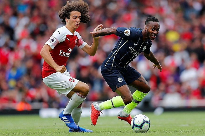 Manchester City forward Raheem Sterling fending off the challenge of Arsenal midfielder Matteo Guendouzi in the Premier League champions' 2-0 win at the Emirates Stadium on Sunday. The 23-year-old Sterling, whose opener for City was his 50th league g