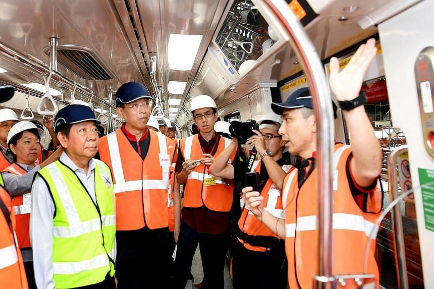 Transport Minister Khaw Boon Wan (far left) and new SMRT chief executive officer Neo Kian Hong (beside him) at the pre-launch of the new trains at Bishan depot yesterday.