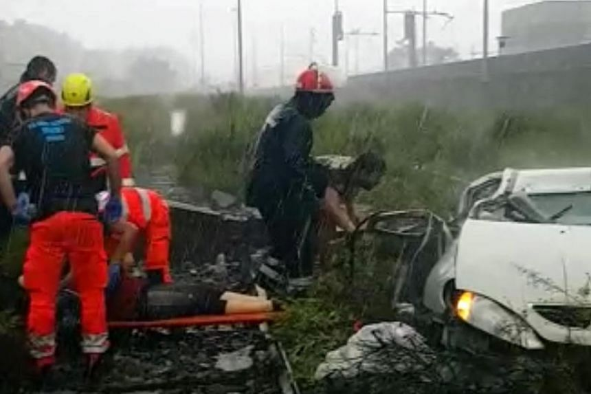 Rescue teams on the site of a collapsed bridge over the A10 highway in Genoa, Italy, on Aug 14, 2018.