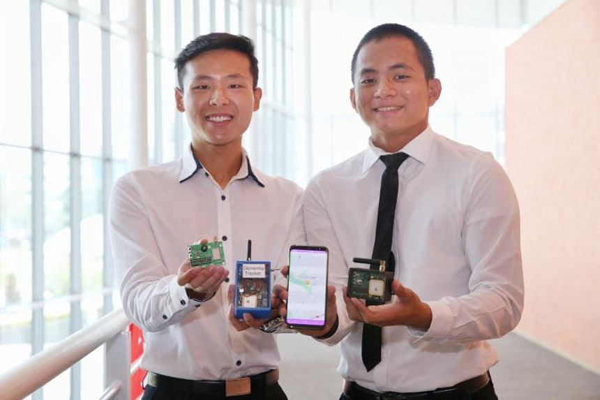 The Lee Hsien Loong Interactive Digital Media Smart Nation Award recipients Chryston Chua (right) and Neo Yizhe with their project titled Dementia Patient Tracker using Sigfox.