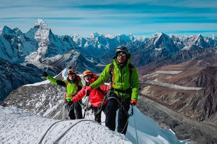 Myanmar mountaineers (from right) Aung Khaing Myint, Zaw Zin Khine, and Pyae Phyo Aung during their ascent of Ama Dablam mountain in Nepal, in preparation for a mountaineering expedition to Hkakabo Razi, on Nov 13, 2017.