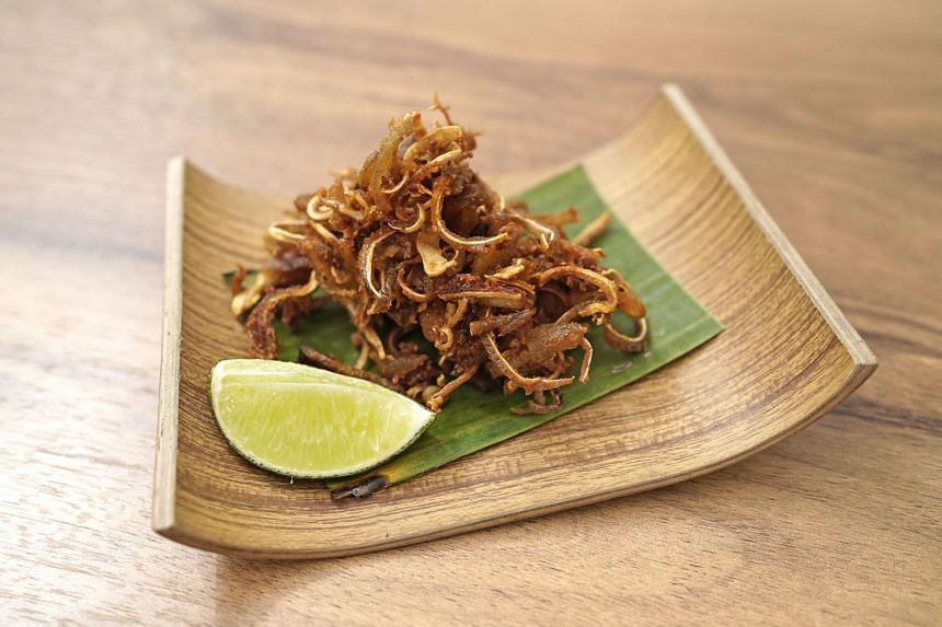 Seasoned simply with curry powder and salt, the Crispy Pig Ears make a great bar snack. Squeeze the lime over it for extra kick.