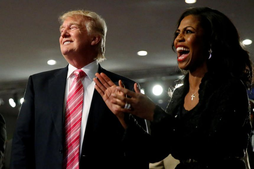 Republican presidential nominee Donald Trump and Omarosa Manigault (right) attend a church service, in Detroit, Michigan, US, on Sept 3, 2016.