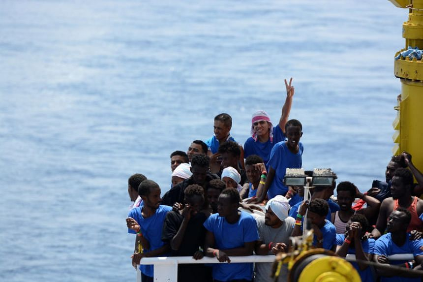 Migrants onboard the MV Aquarius rescue ship run by SOS Mediterranee organisation and Doctors Without Borders during a search and rescue operation in the Mediterranean Sea, off the Libyan Coast, on Aug 12, 2018.