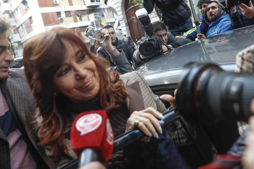 Former president of Argentina Cristina Fernandez (centre) attend a hearing in court in a case of an alleged network of bribes of public works linked with officials of her government, in Buenos Aires, Argentina, on April 13, 2018.