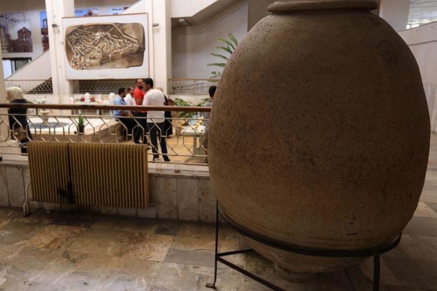 Syrian stroll at the Idlib Museum after it reopened on Aug 13, 2018 in the northern Syrian city of Idlib.