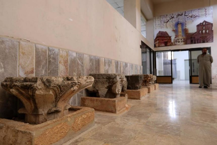 A man strolls at the Idlib Museum after it reopened on Aug 13, 2018 in the northern Syrian city of Idlib.