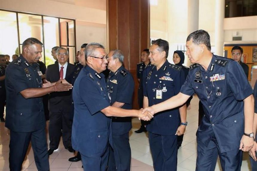 Inspector-General of Police Mohamad Fuzi Harun (centre) at the launch of the Professional Communication Special English Course at the Police Training College in Kuala Lumpur. This follows a recent directive by Prime Minister Mahathir Mohamad for seni