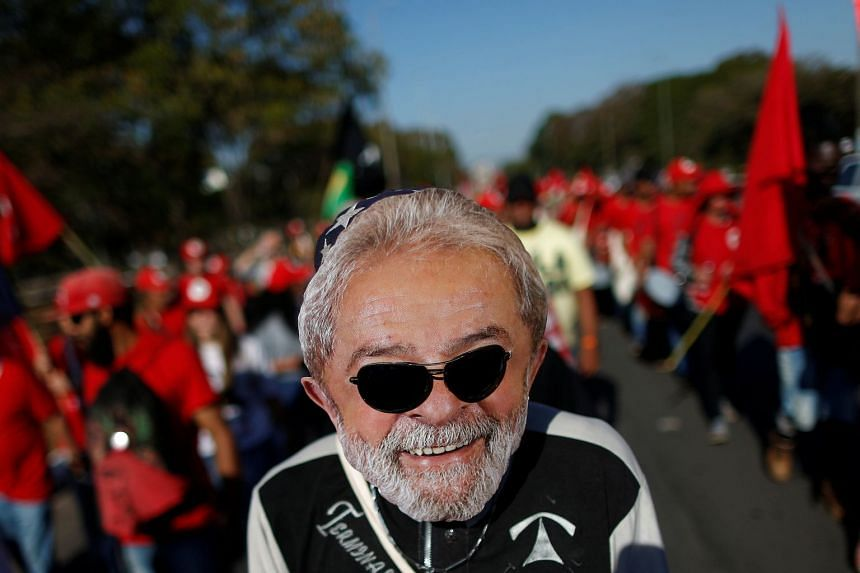 Lula supporters walk during a Free Lula March in Brasilia, Aug 14, 2018.