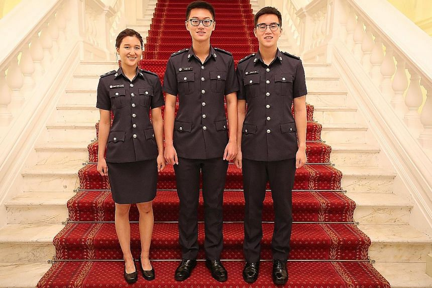 (From left) Ms Cammy Chua, Mr Alden Tan and Mr Stefan Liew at the Istana yesterday, where they were among 17 recipients who were awarded scholarships to pursue careers with the Home Team.