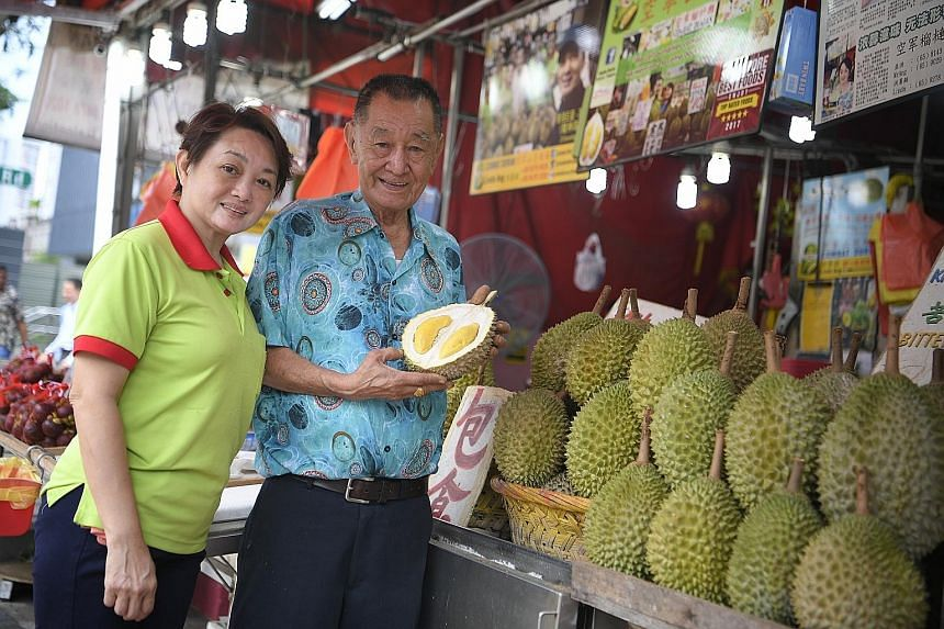 Mr Ang Seck Puan, the boss of Combat Durian, with his daughter Linda at their Balestier stall. Mr Ang is known to durian-lovers for coining catchy durian names such as Sultan Durian, and King Of Kings or Wang Zhong Wang.