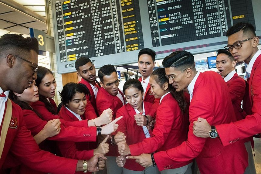 The Singapore silat team doing a cheer before leaving yesterday for the Aug 18-Sept 2 Asian Games, together with chef de mission Lee Wung Yew. The Republic is sending its largest contingent of 265 athletes across 21 sports to the Games in Jakarta and