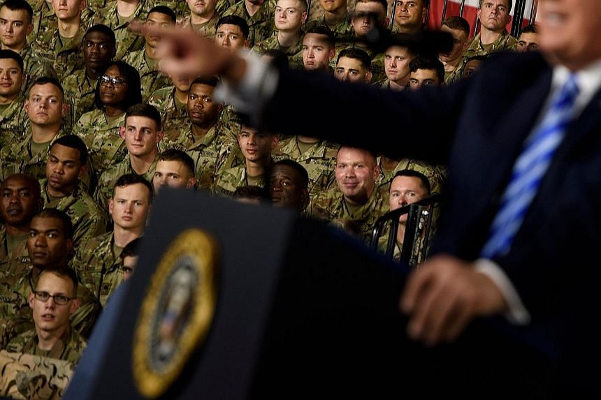 US President Donald Trump speaking at the signing ceremony for the John S. McCain National Defence Authorisation Act at Fort Drum, on Monday. The final National Defence Authorisation Act strengthens the Committee on Foreign Investment in the United S