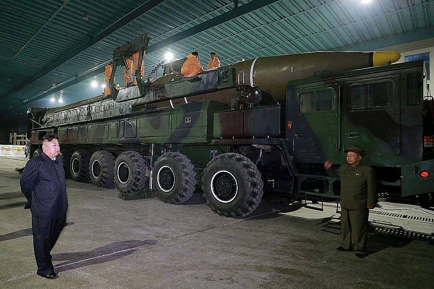 North Korean leader Kim Jong Un inspecting the intercontinental ballistic missile Hwasong-14 in July last year. Concern about US missile defences has grown with the escalating threat from North Korea. Last year, North Korea conducted about a dozen mi