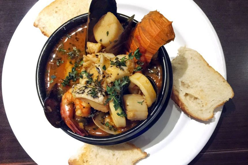 The Cacciucco alla Livornese, tomato-based sauce of seafood like mussels, shelled prawns, squid, clams, crayfish and cod, from Capri Trattoria & Pizzeria at 3 Binjai Park.