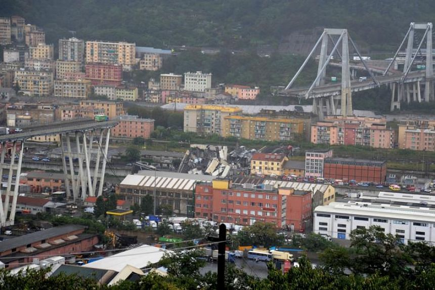 The collapsed Morandi Bridge in the Italian port city of Genoa, on Aug 14, 2018.