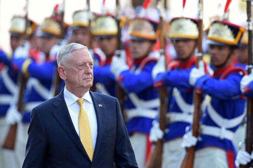 Mattis reviews the honour guard on his arrival in Brasilia,  on Aug 13, 2018.
