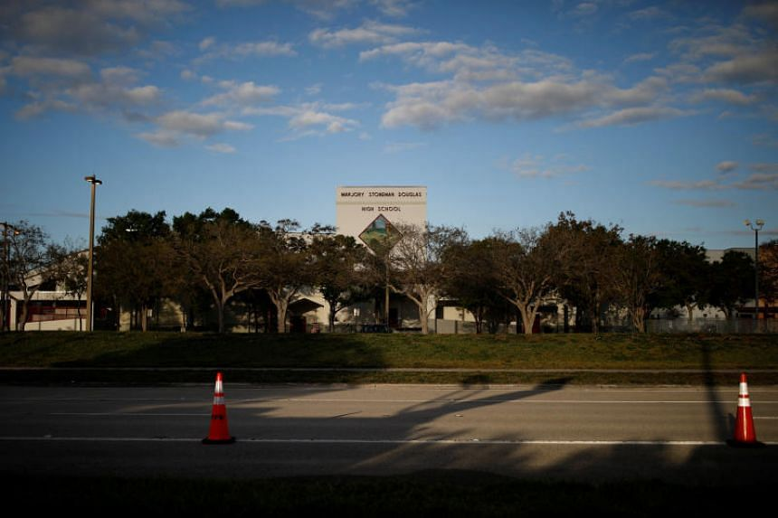 Marjory Stoneman Douglas High School has doubled its campus security detail to 18 and the students must wear identification badges as they funnel through three entrances when they arrive at the sprawling campus.