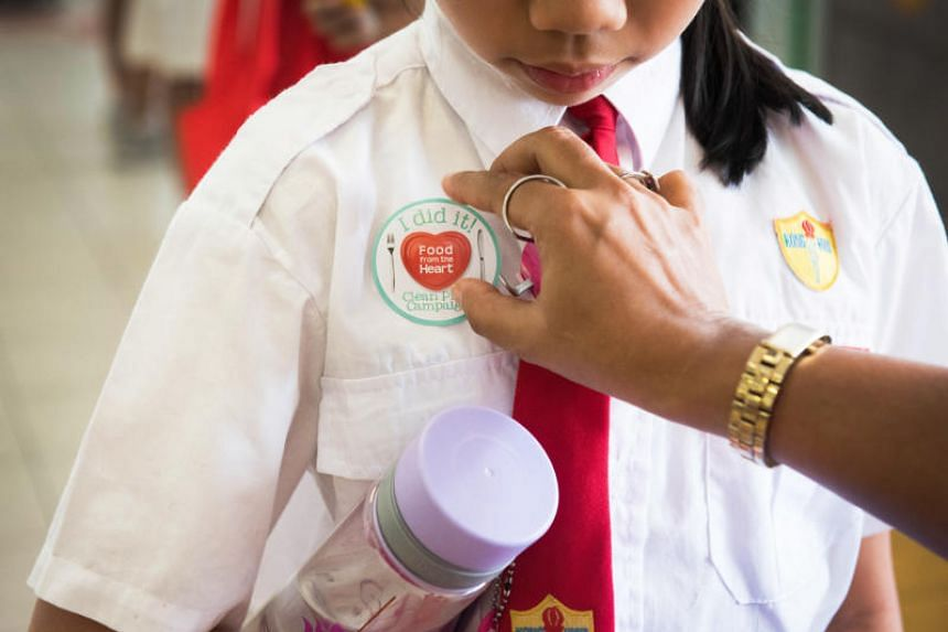 Students at Kong Hwa School were given stickers as part of the campaign.