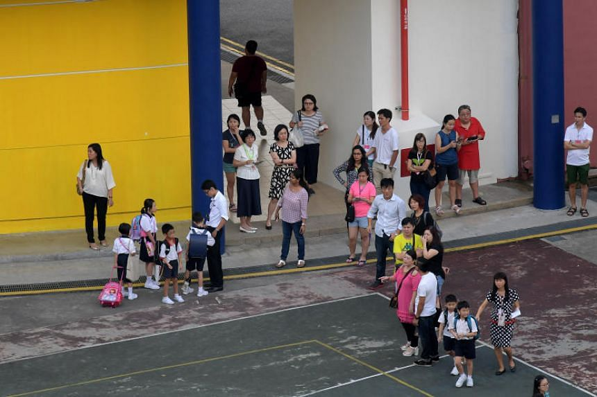 Pupils and parents during the first day of school at Geylang Methodist Primary School, on Jan 3, 2017. The 2019 school year will begin on Jan 2 and end on Nov 15, according to the Ministry of Education.