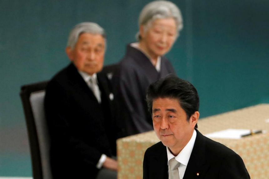 Japan's Emperor Akihito and Empress Michiko look at Prime Minister Shinzo Abe during a memorial ceremony marking the the 73rd anniversary of Japan's surrender in World War II, at Budokan Hall in Tokyo, Japan on Aug 15, 2018.