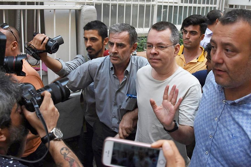US pastor Andrew Brunson reacts as he arrives at his home after being released from the prison in Izmir, Turkey, on July 25, 2018.