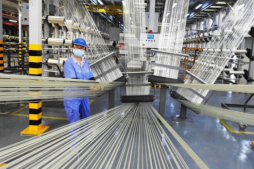 An employee works on a carbon fiber production line at a factory in Lianyungang in China's eastern Jiangsu province, on Aug 9, 2018.