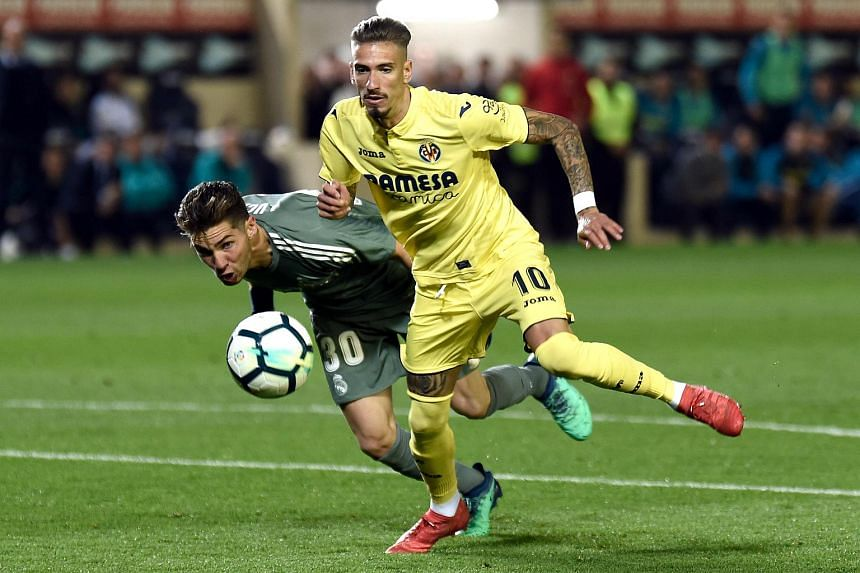 Real Madrid's French goalkeeper Luca Zidane Fernandez (left) tries to block a shot on goal by Villarreal's Spanish midfielder Samuel Castillejo during the Spanish league football match between Villarreal CF and Real Madrid CF, on May 19, 2018.