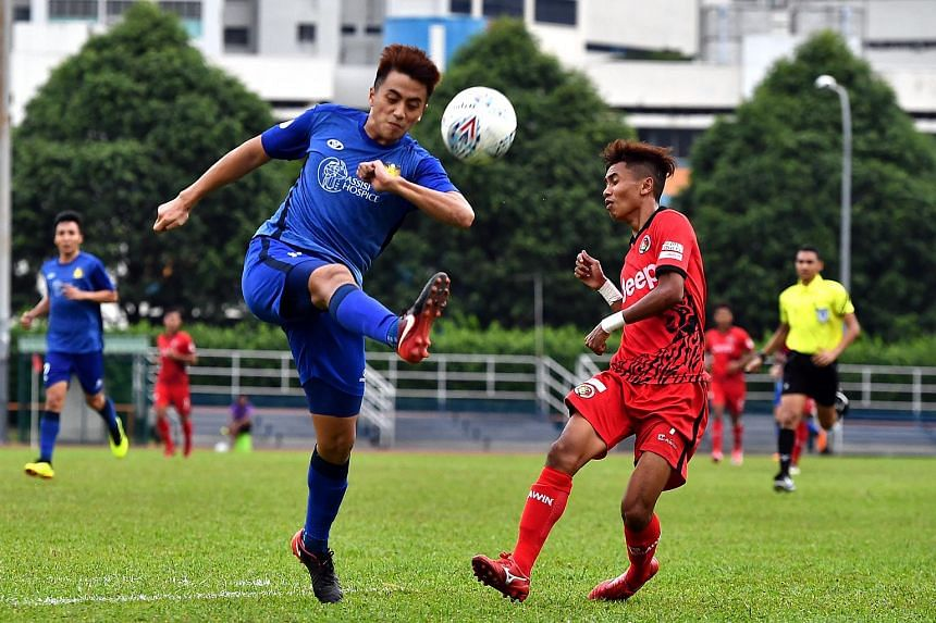 (From left, foreground) Hougang United's Illyas Lee, fighting for the ball with Balestier Khalsa's Hazzuwan Halim, on June 17, 2018.
