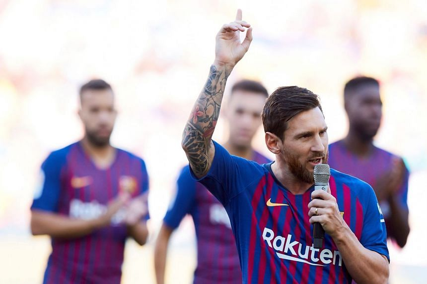 Messi (centre) talking at Camp Nou Stadium in Barcelona in Aug 15, 2018.