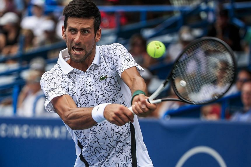 Djokovic in action against Adrian Mannarino of France.