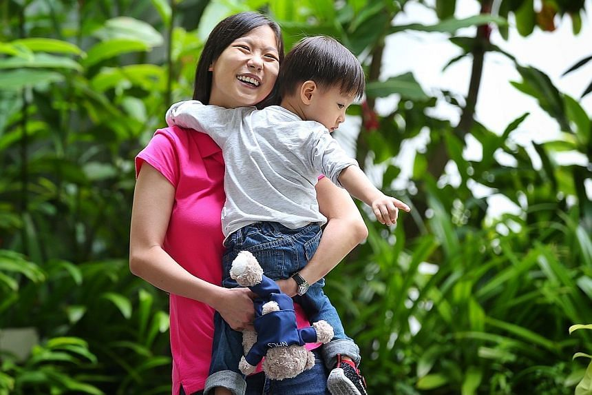 Ms Winnie Tan, 31, with her son Winson, two. She benefited from SGH's joint clinic scheme when she was expecting her first child three years ago. Ms Tan, who was born with two holes in her heart, had a difficult pregnancy. Supervision by doctors from