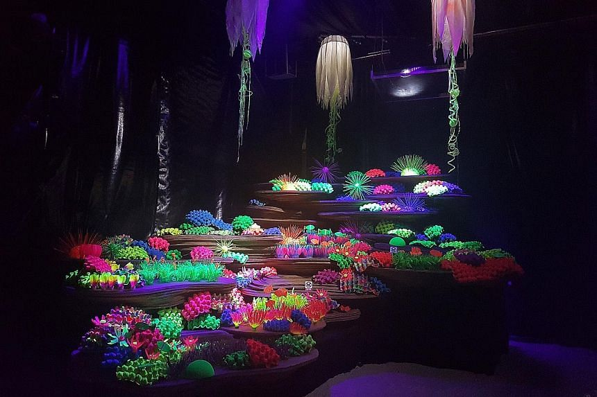 Colourful coral and neon anemones highlight the beauty that exists beneath the waves, but these specimens also remind people of the dangers facing marine life, for they are made of plastic. Titled Plastic Ocean, the display is part of Keppel Club's E
