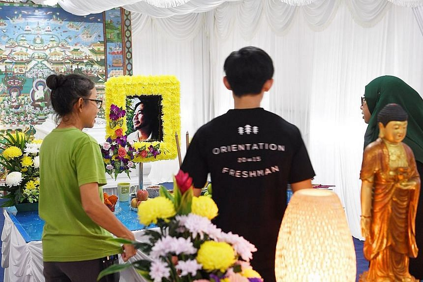 Visitors paying their last respects at the wake of Mr Tay Lai Hock, founder of non-profit organisation Ground-up Initiative, who died suddenly this week.