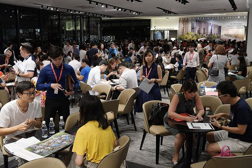 Buyers thronged the Riverfront Residences show flat on the evening of July 5, the day before tighter loan limits and higher Additional Buyer's Stamp Duty were implemented.