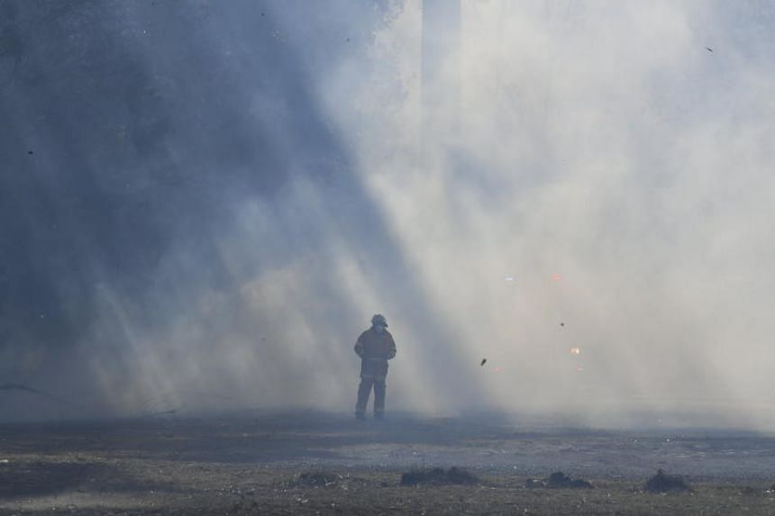 A New South Wales firefighter working to contain a bushfire in New South Wales, Australia, on Aug 15, 2018.