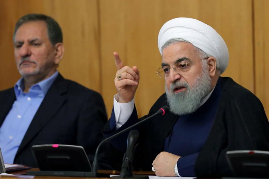 Iranian president Hassan Rouhani (right) speaking during a cabinet meeting in Tehran, Iran, on Aug 15, 2018.