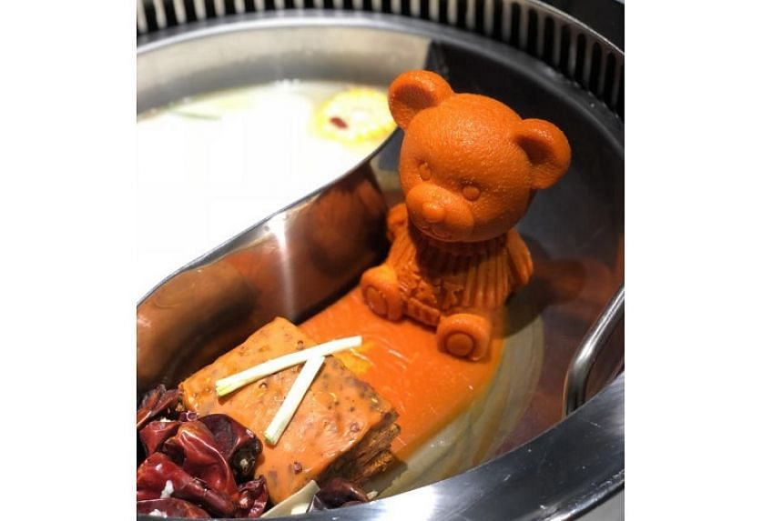 Spice World Hot Pot is known for its mala soup that comes along with a teddy bear made of butter and which melts into the soup once it is placed in the pot.