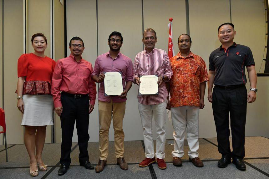 Security Association of Singapore (SAS) president Raj Joshua Thomas (third from left) and Association of Certified Security Agencies (ACSA) president Robert Wiener with their signed memorandums of understanding.
