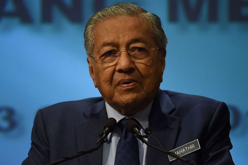Malaysia's Prime Mininster Mahathir Mohamad addresses a press conference at the prime minister's office in Putrajaya on Aug 13, 2018.