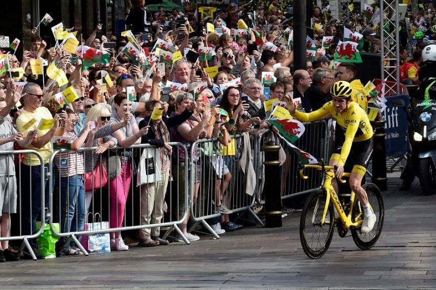 Britain's Geraint Thomas rides during a celebratory homecoming event in Cardiff, south Wales, on Aug 9, 2018.