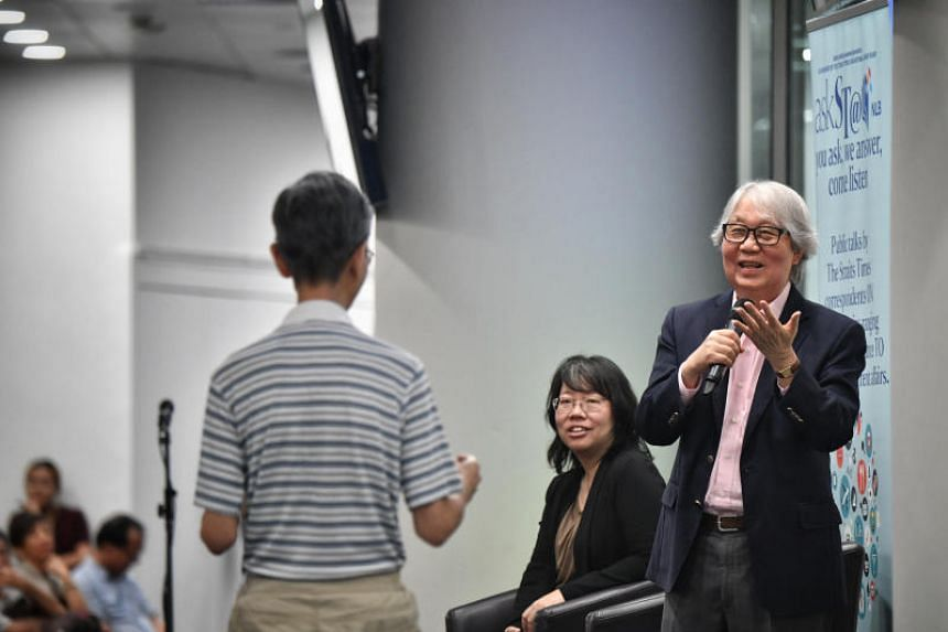 Veteran diplomat Tommy Koh (right) addressed a crowd of 350 at an askST@NLB session on the principles and guidelines that should govern the practice of diplomacy in an uncertain era.