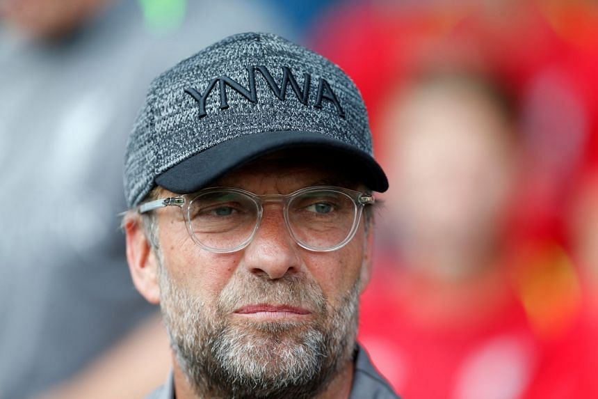 Klopp (above) said Liverpool had to continue to develop with the aim of becoming the best team in the world.