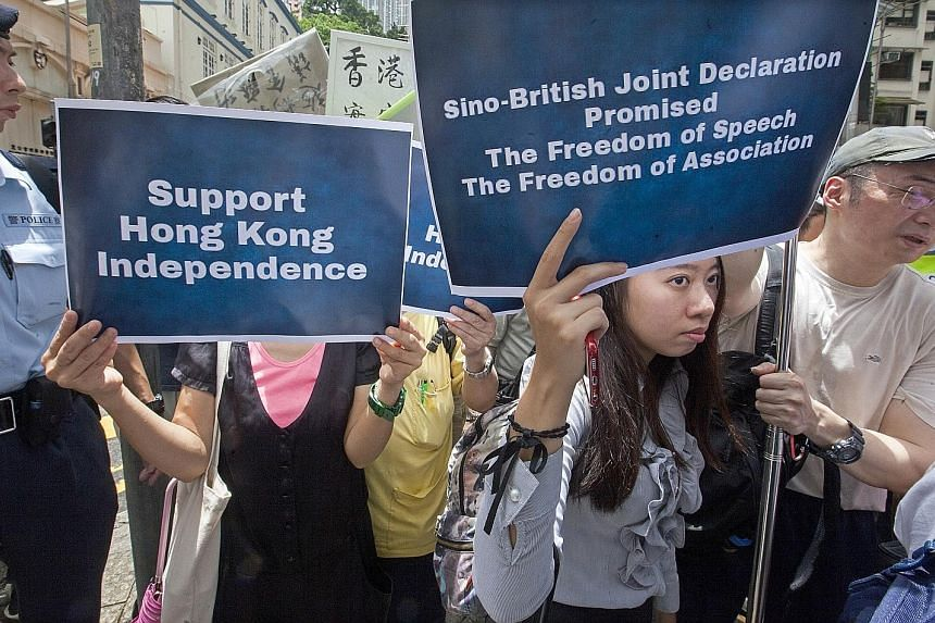 Supporters gathering near the Hong Kong Foreign Correspondents' Club, where a talk was held by a pro-independence activist on Tuesday.