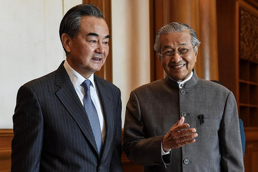 Chinese Foreign Minister Wang Yi meeting Prime Minister Mahathir Mohamad in Putrajaya earlier this month. Experts say Dr Mahathir's visit to China is indicative of China's primacy in Malaysia's foreign policy calculations.