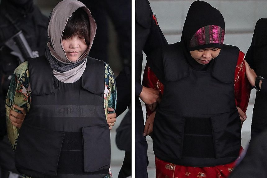 Doan Thi Huong (left) and Siti Aisyah being escorted out of the Shah Alam High Court yesterday. The pair have pleaded not guilty, saying they thought they were involved in a prank for a reality TV show.